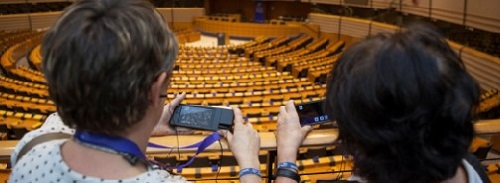 Hemicycle of the european Parliament. Visitors with multimedia guides